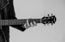 Black And White Photo Of Male Playing On Guitar Hohner.