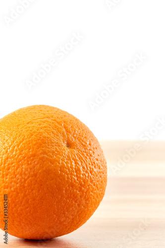 Fresh orange fruit on wooden table isolated