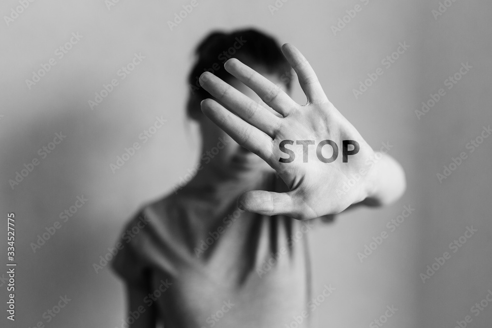 Fototapeta Stop domestic violence. The girl covers her face with her hand and asks for help. Domestic violence against women.