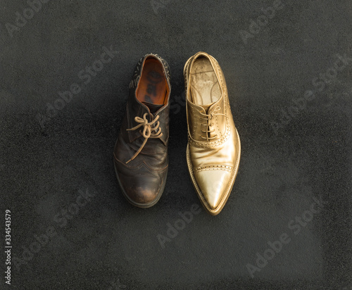 Fototapeta concept of rich and poor in a shoes, old and golden shoe obraz
