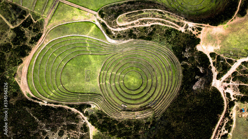 Fotografia Aerial view of Moray Archeological site - Inca ruins of several terraced circular depressions, in Maras, Cusco province, Peru