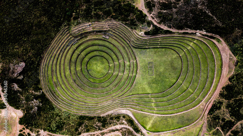 Fototapeta Aerial view of Moray Archeological site - Inca ruins of several terraced circular depressions, in Maras, Cusco province, Peru