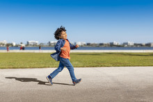 A Little Boy Walks With A Happ...