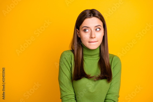 Cuadros en Lienzo Portrait of scared frightened girl made mistake look copyspace bite lisp wear st