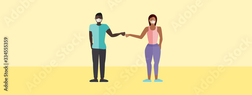 Foto Fist bump greeting concept vector of a man and a woman with masks with copy spac