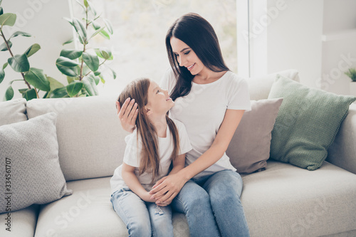 Photo of pretty little girl with young charming mommy hugging looking eyes affec Wallpaper Mural