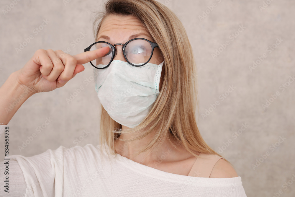 Fototapeta Medical mask and Glasses fogging. Avoid face touching, Coronavirus prevention, Protection.