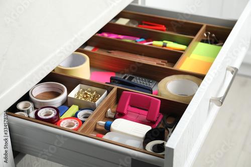 Fotomural Different stationery in open desk drawer indoors