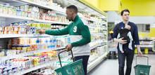 Men Shopping In Supermarket