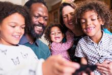 Happy Multiethnic Family Using...