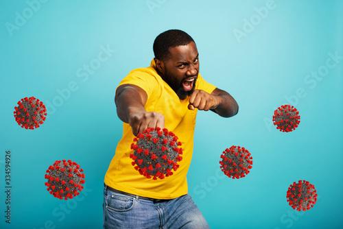 Man attacks with a punch the covid 19 coronavirus Wallpaper Mural