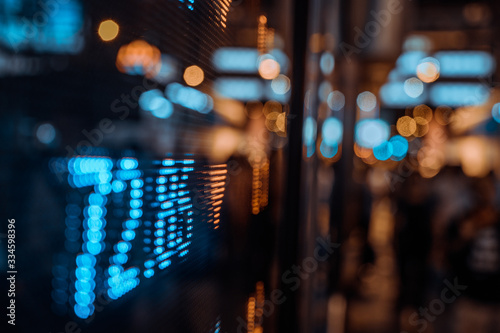 Obraz Display stock market numbers with defocused street lights background - fototapety do salonu
