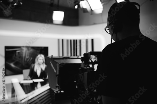 Recording at TV news studio positioned camera equipment with television presenter journalist reporting worldwide Fototapete