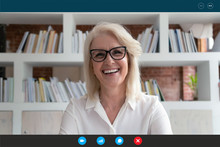 Headshot Portrait Screen Application View Of Smiling Elderly Woman Look At Camera Talk On Video Call With Relatives, Happy Mature Female Go Online Speak Using Webcam, Communicate On Computer