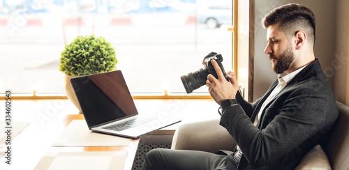 Obraz na plátne Caucasian adult bearded man indoors in cafe