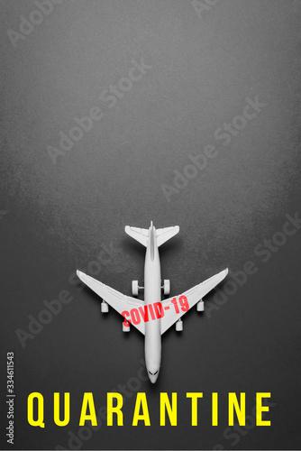 Fotografía plane on dark background with text quarantine due to the impact of coronavirus concept