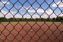 Baseball Field Through Grid Of Chain Link Fence