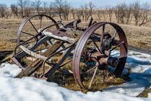 Close Up Of Broken Steel Wagon Wheels Abandoned In A Field In Saskatchewan