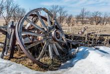 Close Up Of A Broken Wooden Wagon Wheel Abandoned In A Field In Saskatchewan