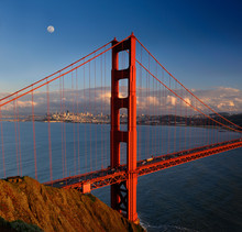 Golden Gate Bridge With San Francisco Skyline And Moon At Sunset