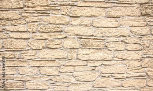 Fotomural Texture of stone wall, square yellow travertine tile.