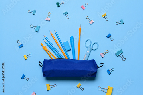 Photo Pencil case and school stationery on color background