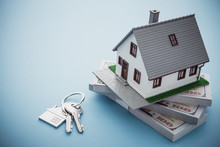 House Model, Bill Dollar Banknotes And Key On Blue Background With Copy Space. Money Saving For New House, Home Loan, Reverse Mortgage And Real Estate Property Business Concept