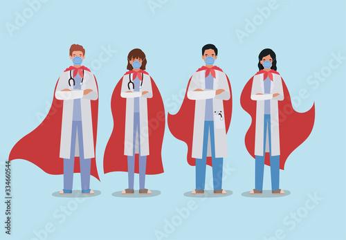 Fotografía women and men doctors heroes with cape against 2019 ncov virus vector design