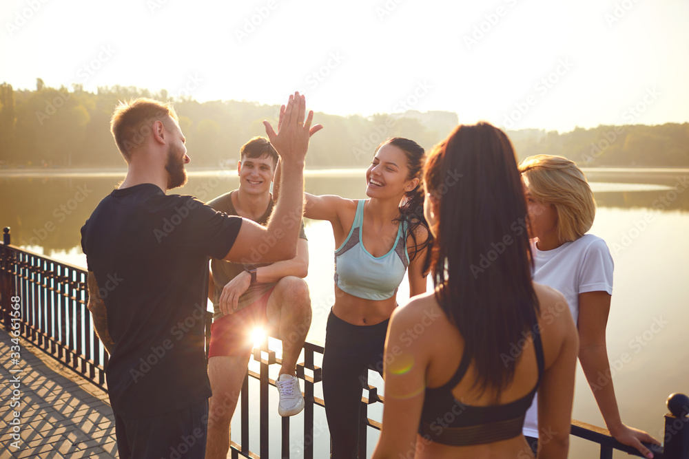 Fototapeta A team of athletes training together.