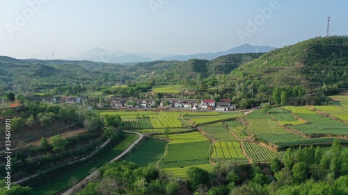Early morning beautiful countryside with green farmland landscape