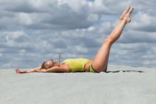 Seductive Woman In Stylish Swimsuit Kneeling In Sand