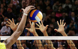 Volleyball spike blocking in front of  the net