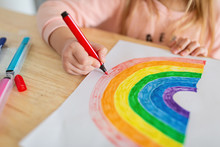 Kid Painting Rainbow During Co...