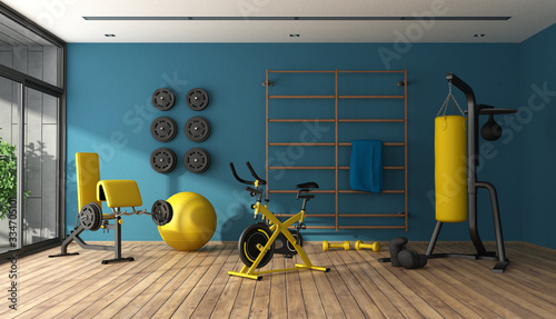 Fotografia Blue home gym with black and yellow fitness equipment