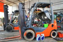 Parked Forklifts In Repairing Workshop