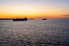 Cargo Ships In Sunset Light