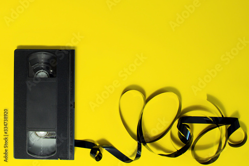 Fotografija Cassette for a VCR  video recorder on a yellow background