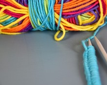 Ball Of Rainbow Yarn With Knit...
