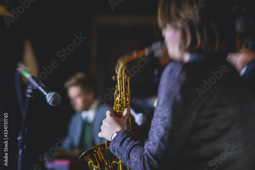 Tablou Canvas Concert view of a female saxophonist,  professional saxophone player with vocali