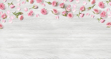 Rose Flowers On White Wooden Background With Copy Space For Design, Text. Top View Of Banner With Pink Roses And Rosebuds. Happy Mothers Day.