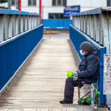 Beggar With Face Mask In City