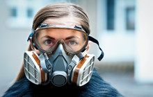 Young Woman Wearing Full Face Respirator Protective Mask And Goggles, Extreme Coronavirus Protection Concept
