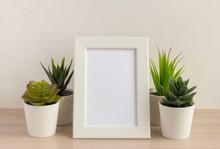An Empty Photo Frame On A Tabl...