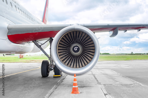 Airplane on airfield, airliner on runway, airplane wing and turbine close up, ai Canvas Print
