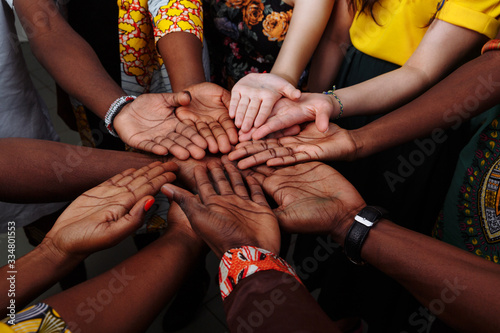 Vászonkép Hands of happy group of multinational African, latin american and european peopl