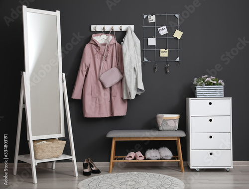 Hallway interior with stylish furniture, clothes and accessories Fotobehang