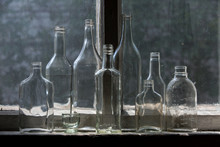 Different Glass Bottles On The...