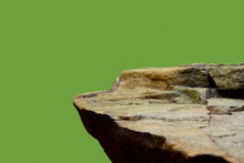 A Rock Mineral, Showing A Rough Texture To The Horizontal Ledge Of The Stone Shelf.