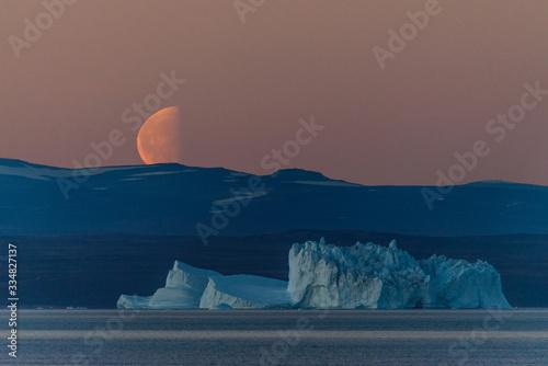 Beautiful moonrise in Greenland. Iceberg at sea. Canvas Print