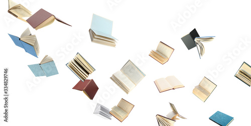 Photographie Old hardcover books flying on white background
